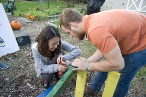 Landscape construction materials class creates colorful benches for ELI's Community Garden