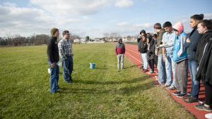 Carrie Murphy and Donald Seifrit discuss agricultural practices with William Penn High School students.
