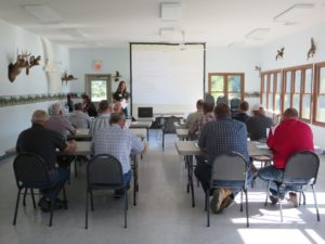 UD's Leah Palm-Forster talks with farmers at the Paulding County Swamp Nature Center in 2013